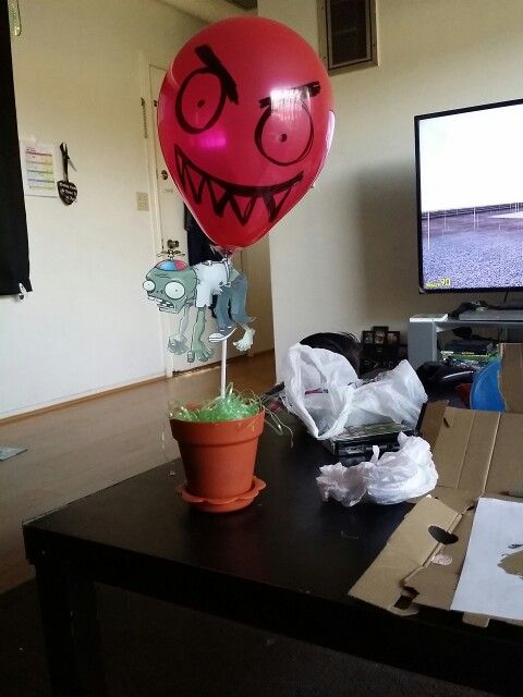 plant vs zombies centerpiece could also use fishing line and tape balloon to ceiling to make it look like its floating without worrying about the weight of
