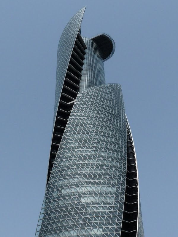 Mode Gakuen Spiral Towers, Nagoya,Japan.The strong inner truss tube is visible through gaps between the three wings, highlighting the bold design and structure while demonstrating the overall consistency.The towers are highlighted with many ecological features, such as a double-glassed air flow window system and a natural air ventilation system.