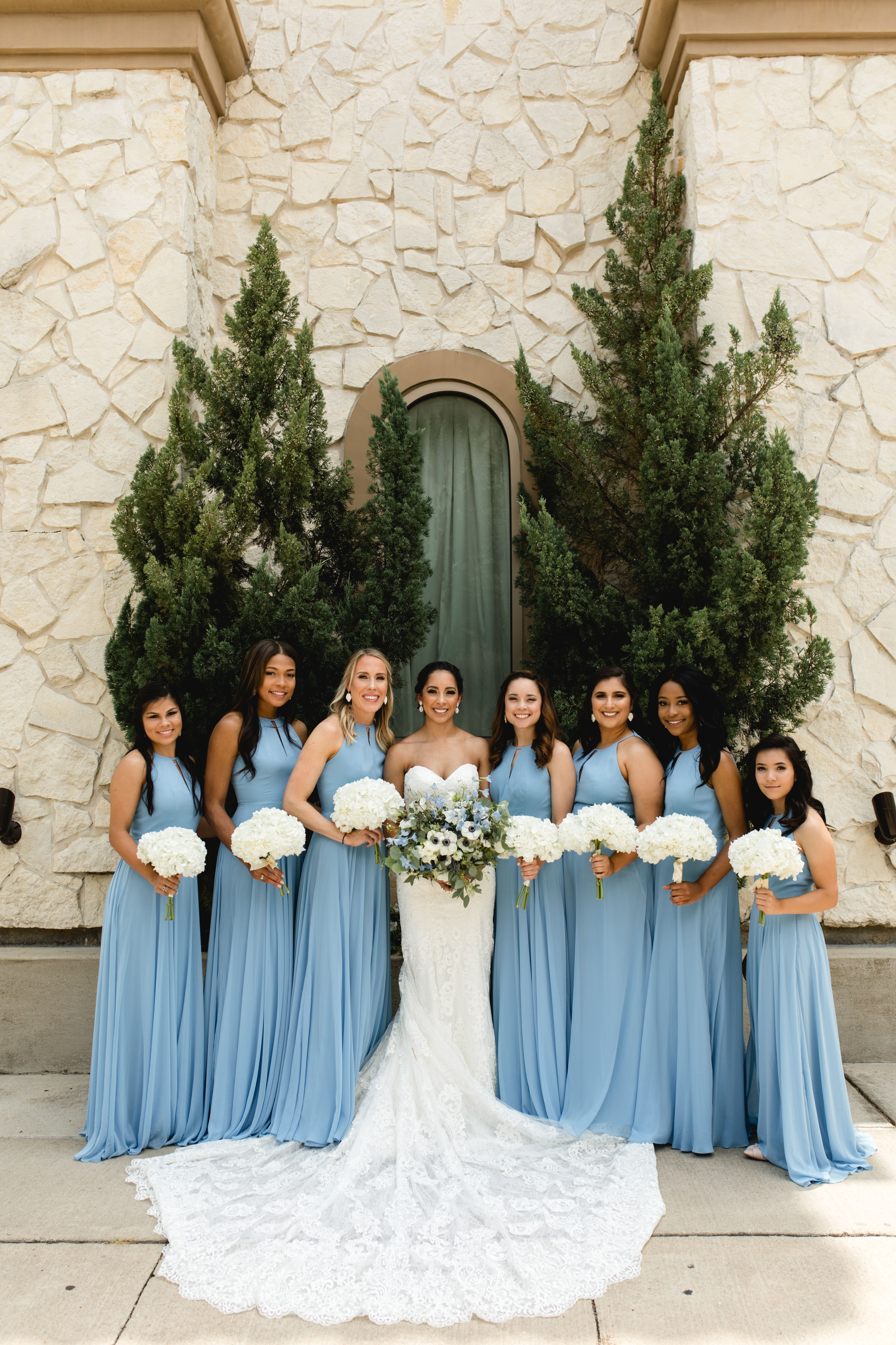 Bridesmaids In Blue At Piazza In The Village Christy Archibald Photography Dark Blue Wedding Blue Winter Wedding Blue Themed Wedding