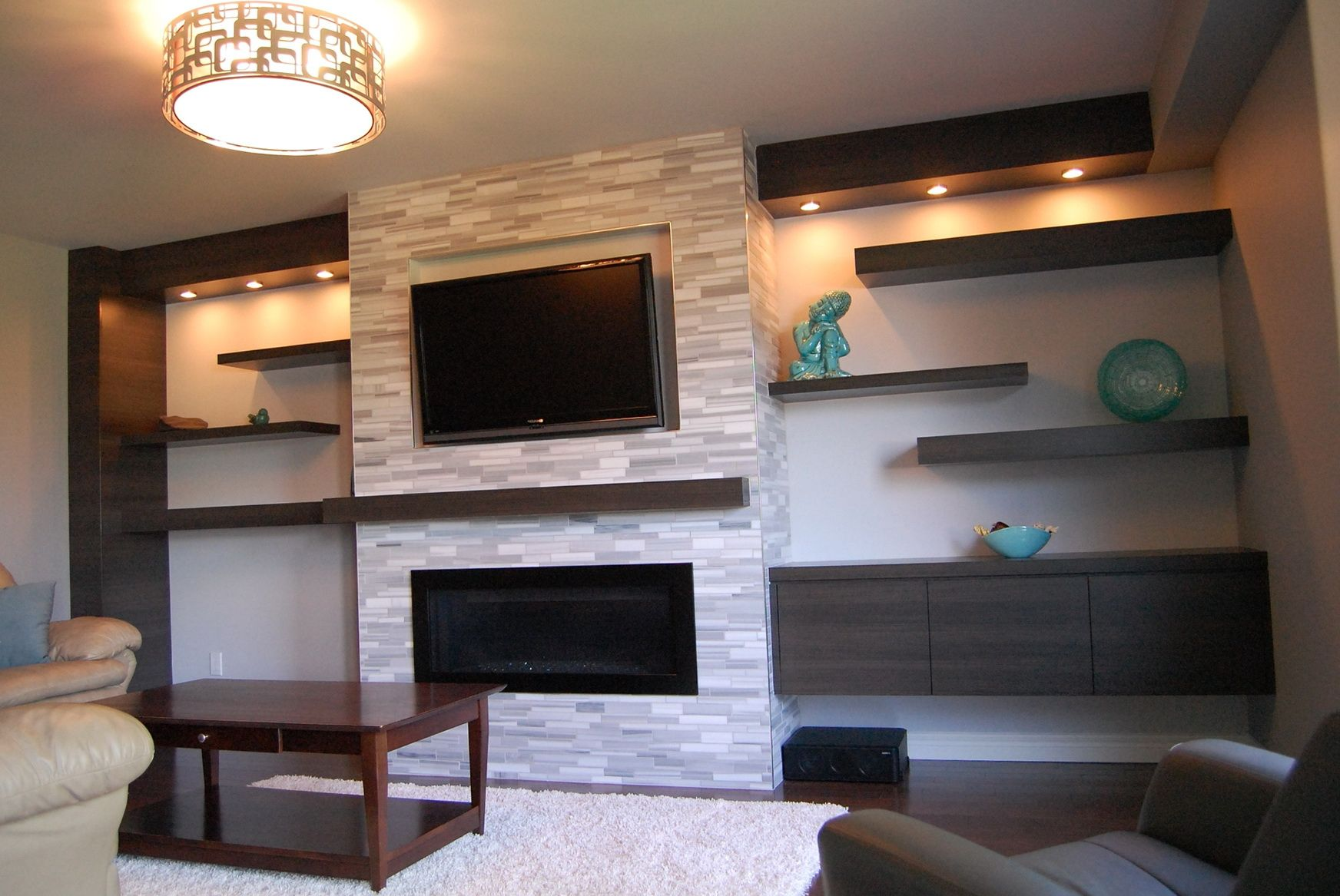 Wall mounted fireplace and floating cabinet and shelves Have the