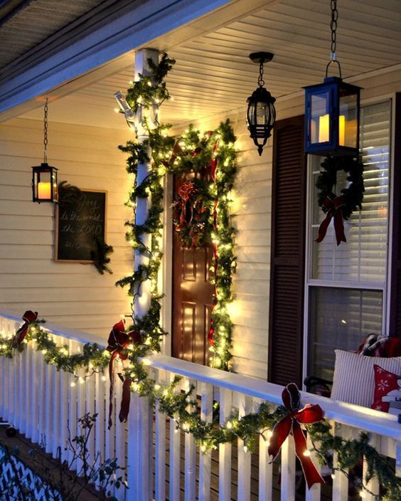 evergreen garlands with lights and red bows
