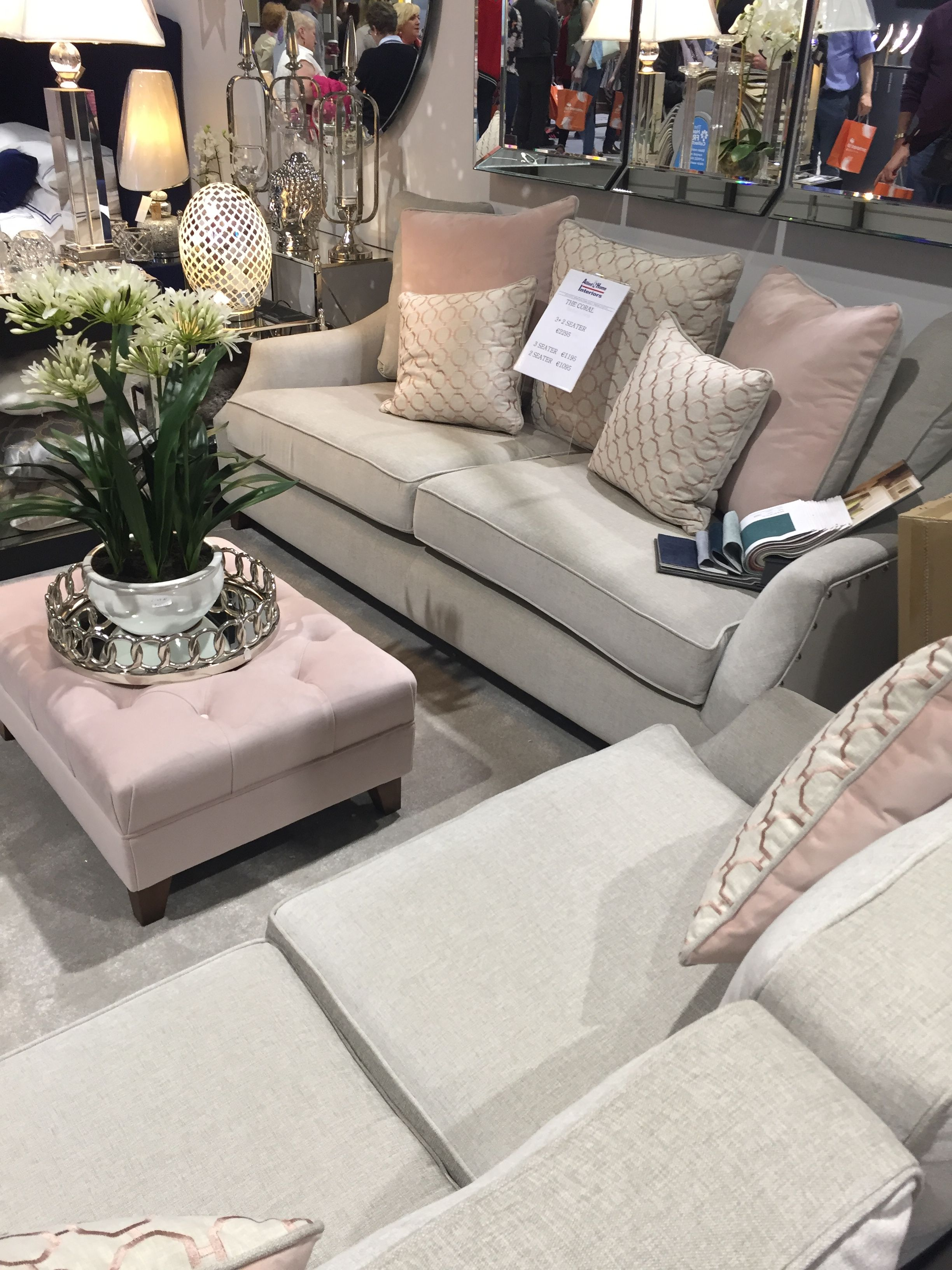 Grey Sofas And Pink Buttoned Footstool At The Ideal Home Show Gray Sofa Footstool Living Room Inspo