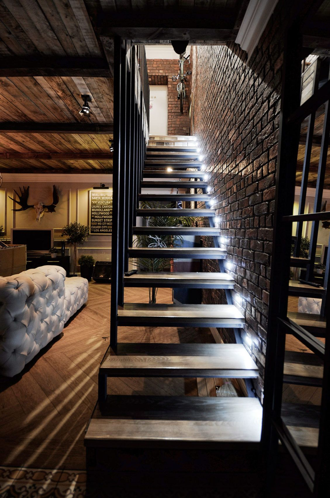 Charming Wooden Stairs And Black Metal Railings