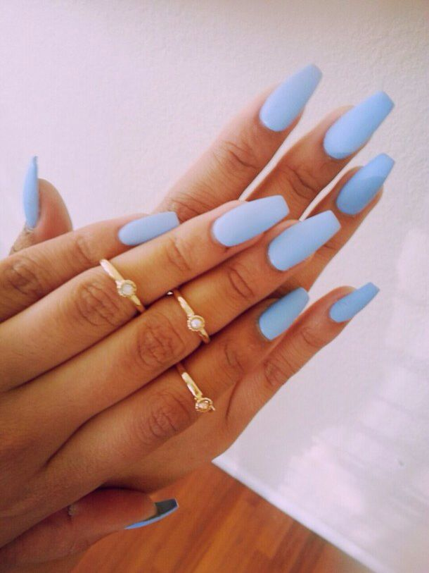 Pale blue almond shaped nails. To die for.