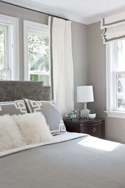 Gray Bedroom Features Gray Walls Framing Gray Velvet Headboard With Silver Nailhead Trim Accented W Grey Bedroom Design Bedroom Makeover Grey And White Bedding