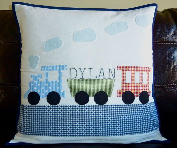 This sweet made-to-order pillow cover fits a 20 x 20 insert. The design of train locomotives is sewn with a raw-edge applique technique. This