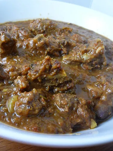 curried goat with rice and peas  goat recipes curry goat