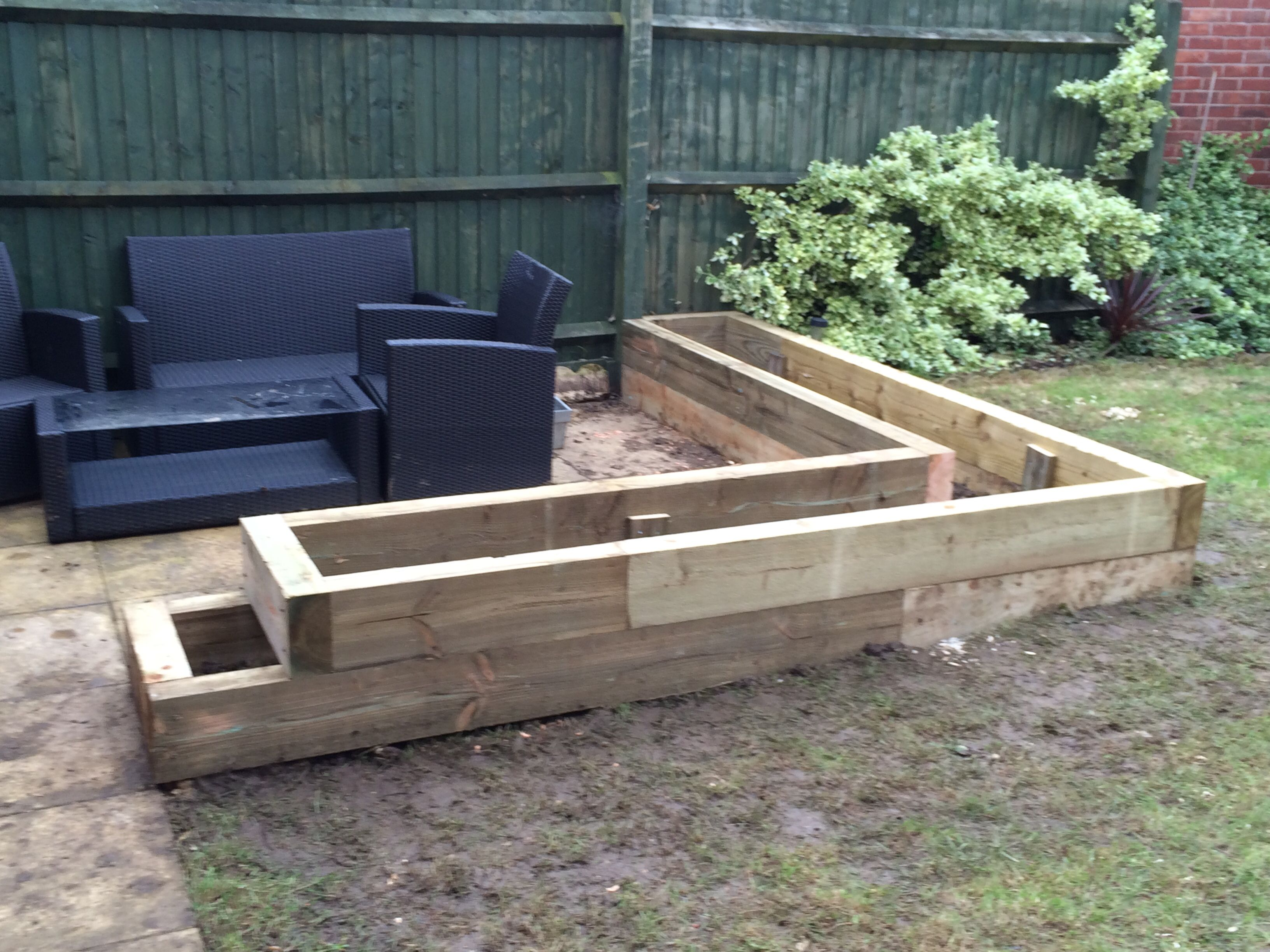 Raised planter made from Eco sleepers to frame patio area
