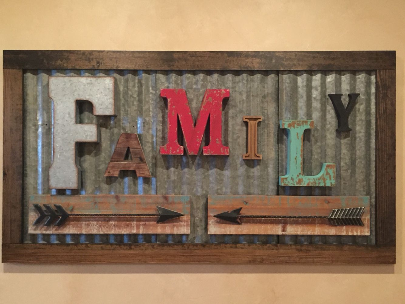 rustic family sign made from vintage letters and old corrugated