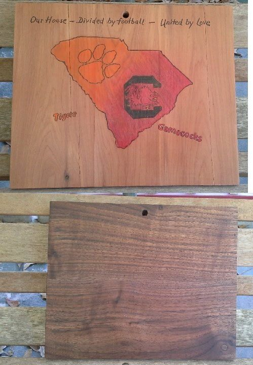 """Hubby is for one team.... Wife is for another team. Kids are caught in the middle and have to wear mismatched colors just so Mom and Dad are both happy. Sound like your house on Football day? Measures 12 x 9.75"""" x 1"""" thick. The board even has a few """"division cracks"""". The walnut cutting side is treated with coconut oil and is ready to chop some veggies so you can snack and hold hands while you watch the game together! https://smolderingcreationswoodburning.com"""