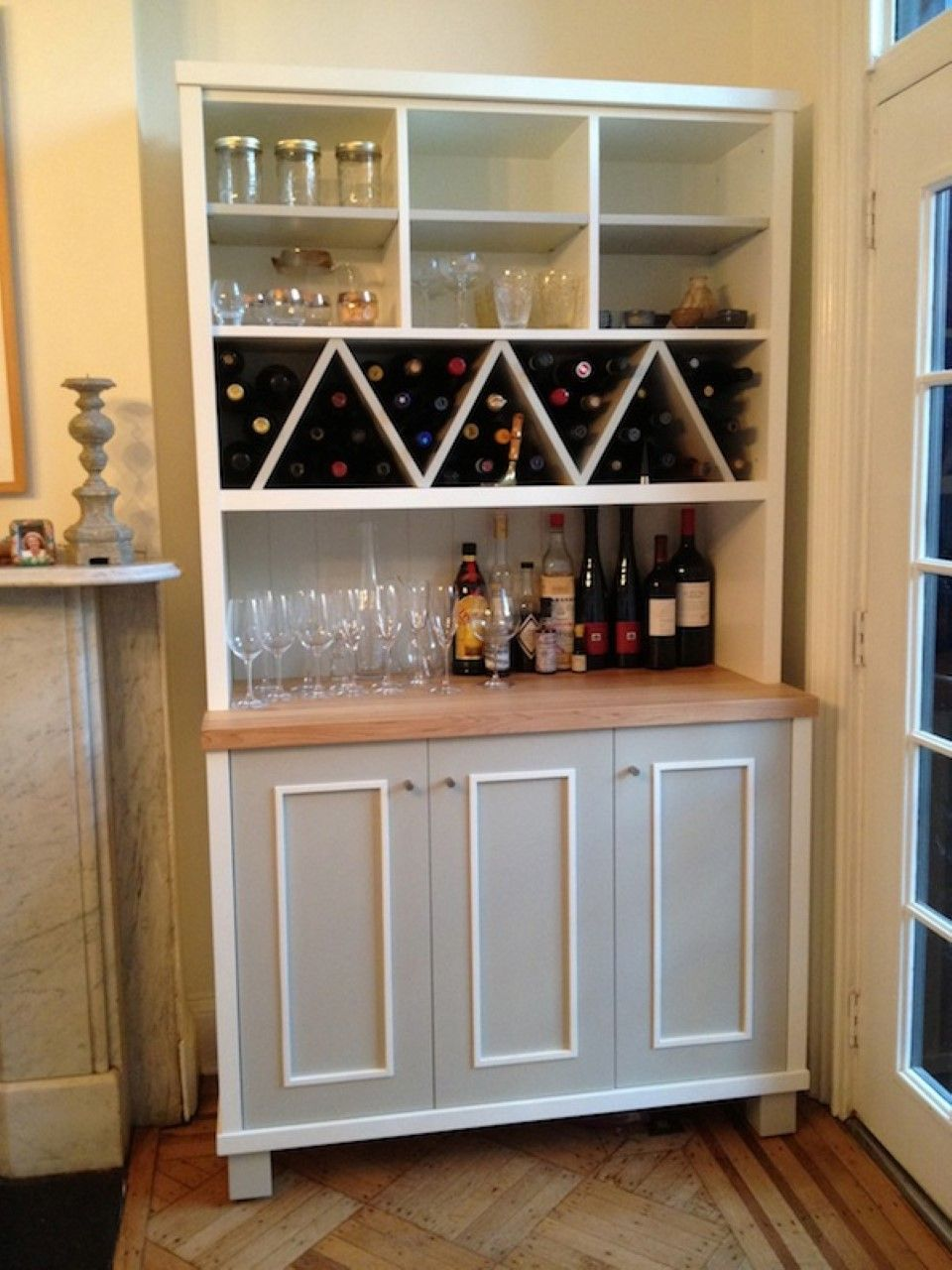 Zigzag shaped wine racks with multi purposes kitchen wall for Cupboard cabinet designs