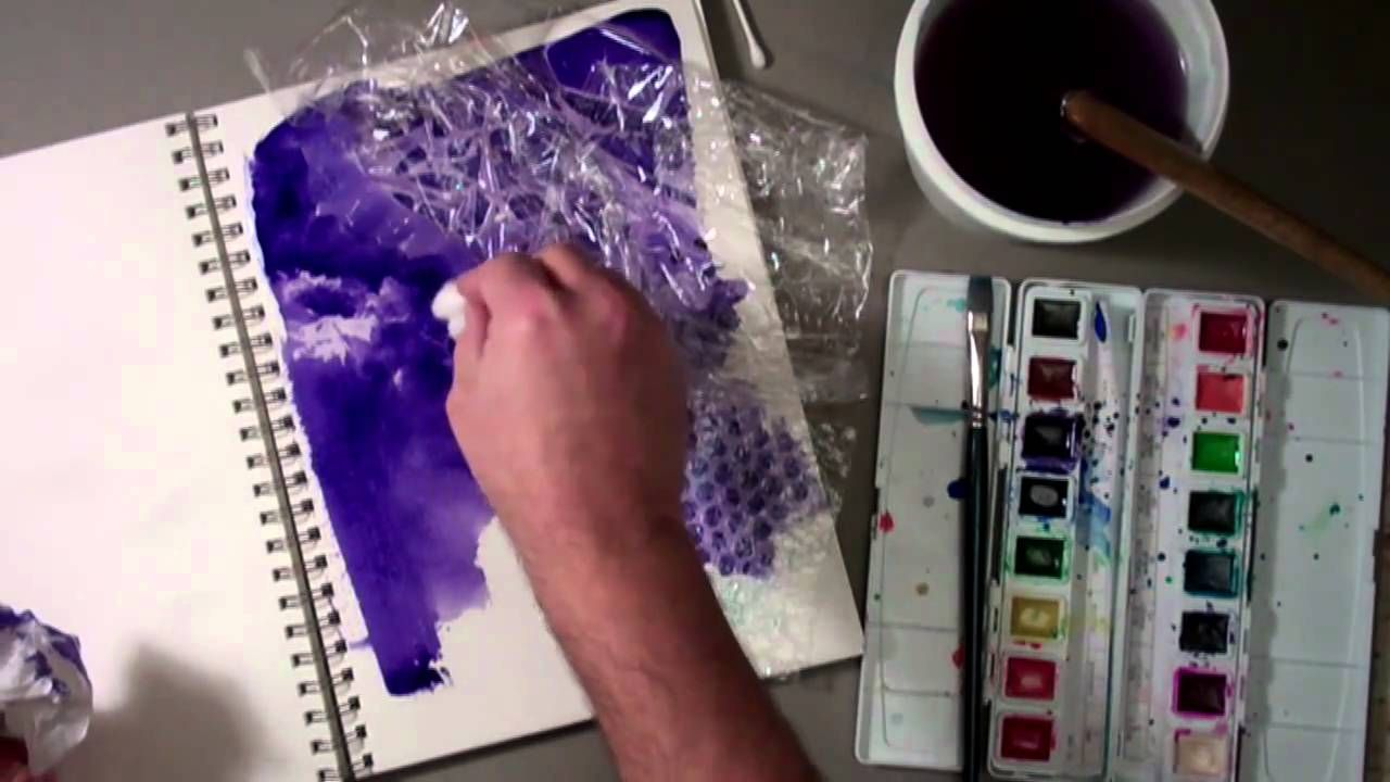 Technique demonstration of lifting watercolor once it is painted down paint with a variety of objects including sponges, cotton balls, plastic wrap, and bubble wrap.