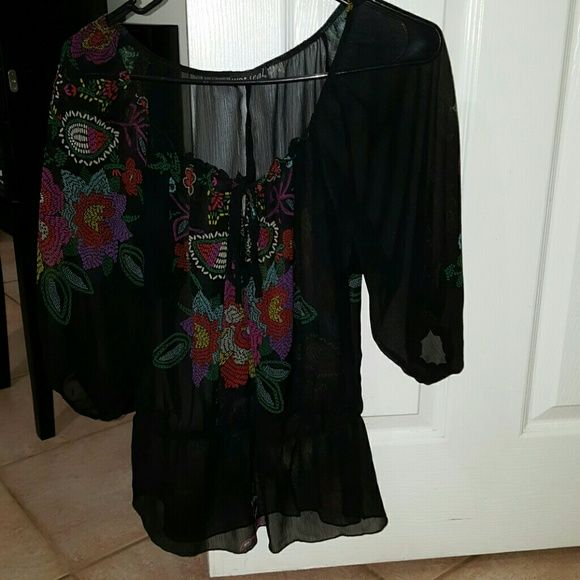 Black see through top NWOT Black see through top with elastic sleeves and waist, tie up front. Pair with your favorite tanks underneath for a cute, layered look. Tops Blouses