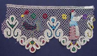 """Bobbin lace from Czechoslovakia, late 19th or 20th century. Eastern European lace is characterized by the use of colored yarns.""  The University of Rhode Island Historic Textile and Clothing Collection houses the collection of Mabel Foster Bainbridge, a recognized authority on needlework. In the early twentieth century she collected laces and embroideries, together with books on the subject, from all over the world. Items in the collection date from the 17th through the 20th centuries."