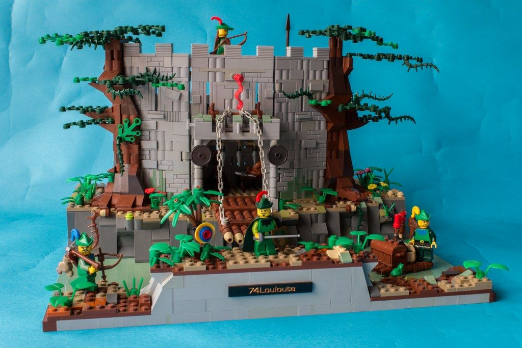 https://flic.kr/p/dvUdzA | 6077 Forestmen's River Fortress Redux | This is my entry into the Classic Set Revisited for the CCCX.  I revisited the 6077 Forestmen's River Fortress The whole set includes 5 minifigs (4 forestmen and 1 soldier), 1 raft, 1 fortress with moving drawbridge, 3 animals, and a great playability by the back !  For more views, please follow these deeplinks to brickshelf : 1 - 2 - 3 - 4 - 5 - 6
