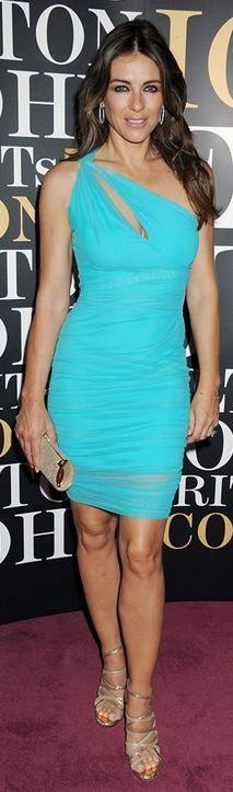 Who made  Elizabeth Hurley's gold clutch handbag and blue cut out one shoulder dress? #maturemodelling