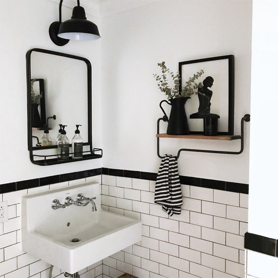 @homesweetfarmhm posted to Instagram: This simple bathroom from @disheveleddelight makes my heart skip a beat. I love the floating shelf, the black and white tiles and that sink is on point! ::::: #farmhouse #farmhousestyle #modernfarmhouse #farmhousedecor #neutraldecor #fixerupper #interiorstyling #interiorinspo #blackwhitebathrooms