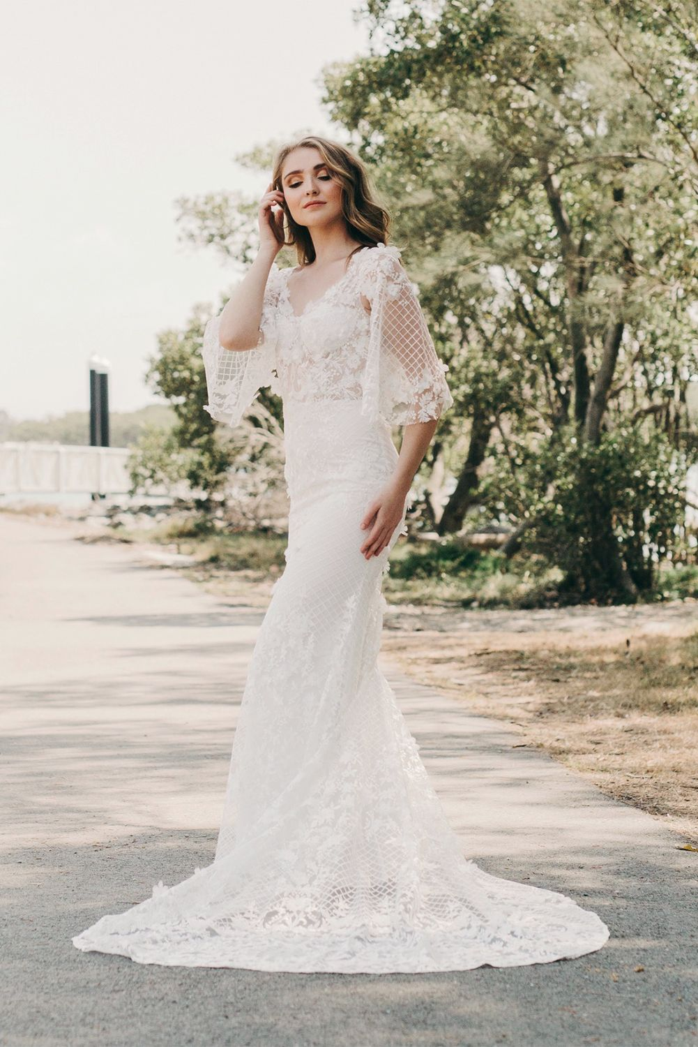 Lace wedding gown with flowing sleeves mia by goddess by nature