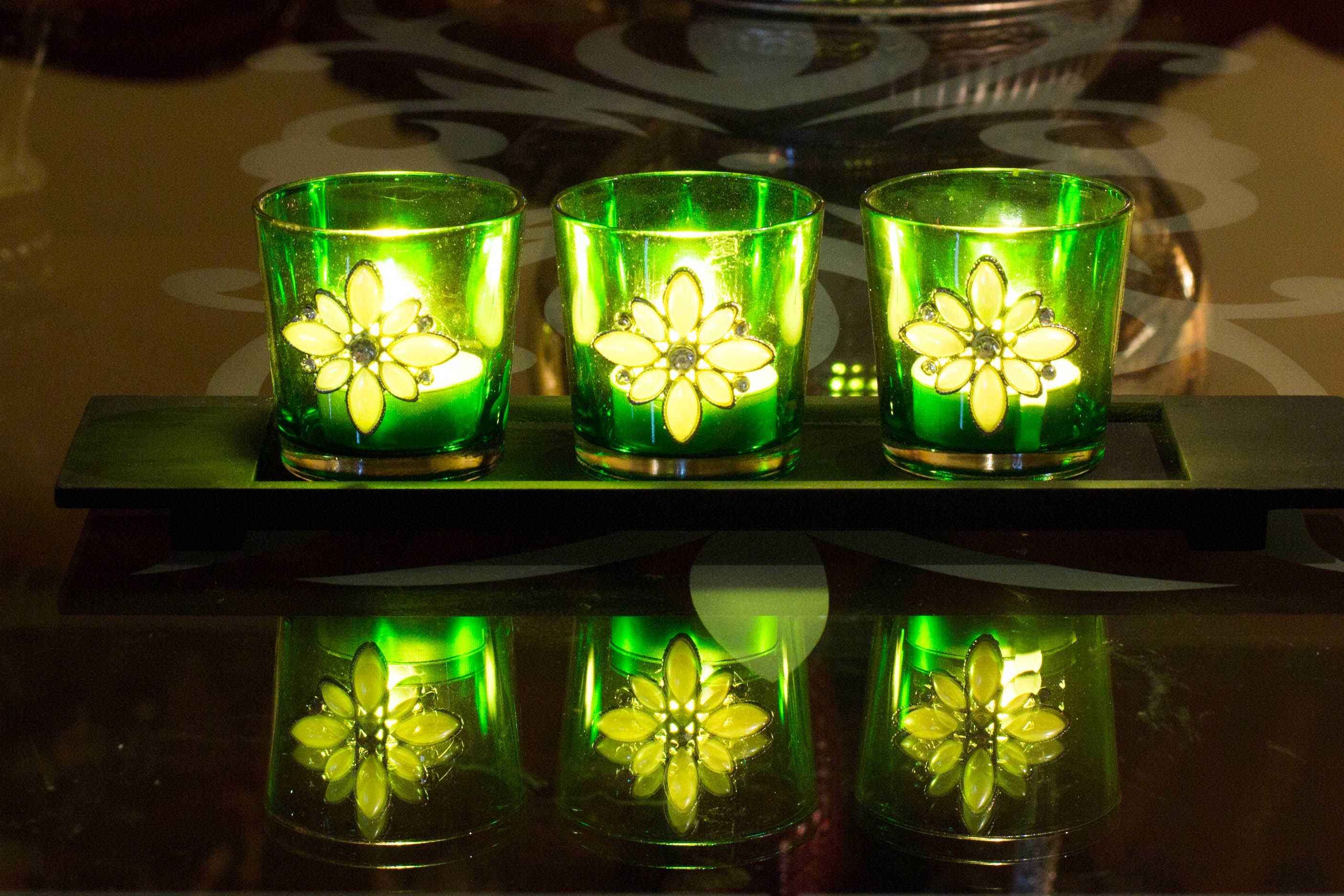 Dress up your home by using this Jeweled Glass Votive on a wooden tray for displaying tea light or sphere candles adding sparkle & glow to your Home.