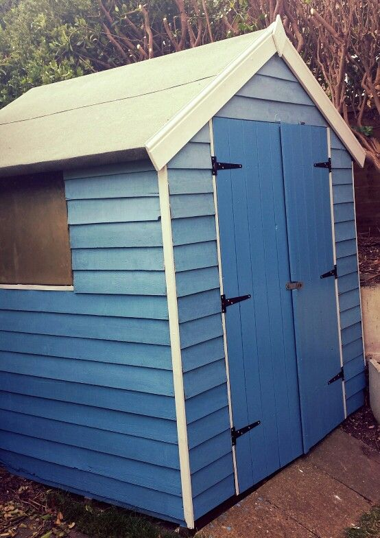 Painted our ugly old shed in shades of blue.