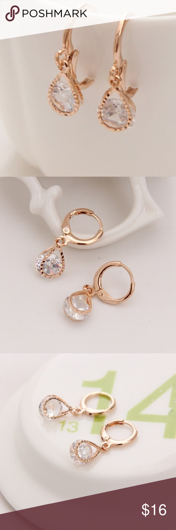 18k Gold Plated AAA CZ Earrings Teardrop setting A Unique 18k Rose Gold Plated Teardrop Shaped Setting in Front & Back Gently Hugs the Crystal Clear Brilliant Cut AAA CZ in place. Allows the CZ to catch light so it shimmers and shines with movement. These are a soon to be classic in any womans collection. The earrings measure at 1 inches from top to bottom and .31 inches wide. Jewelry Earrings