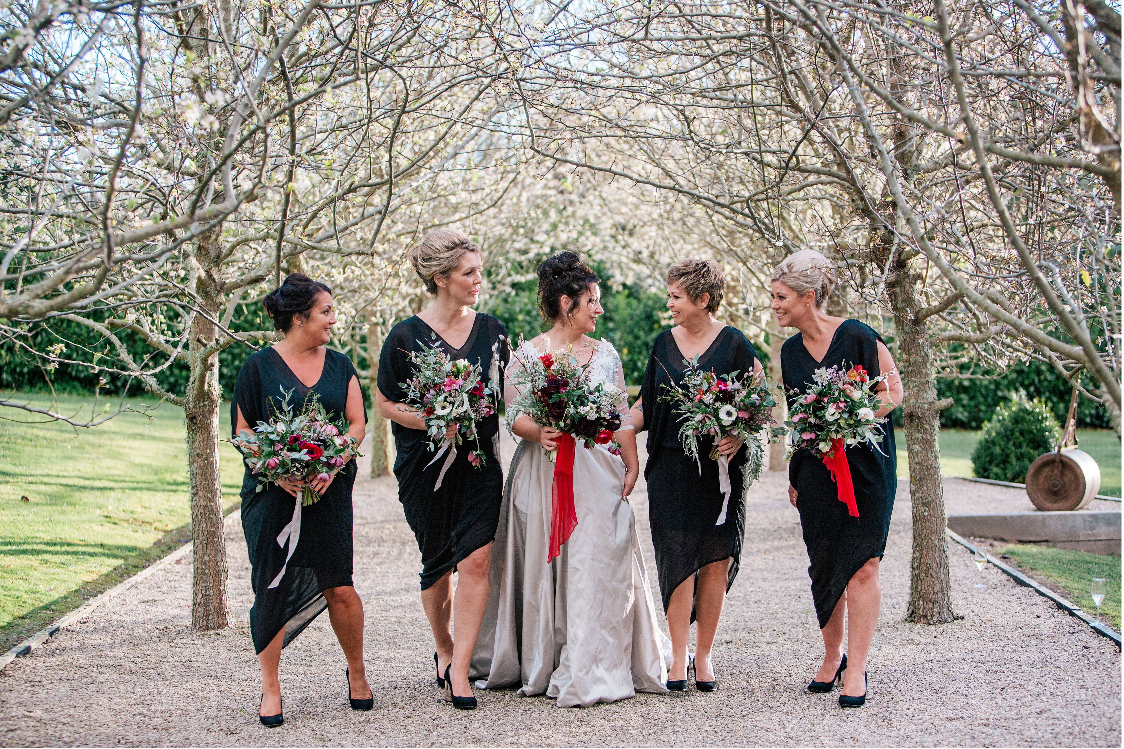 Mel and all of her bridesmaids, wearing Moochi