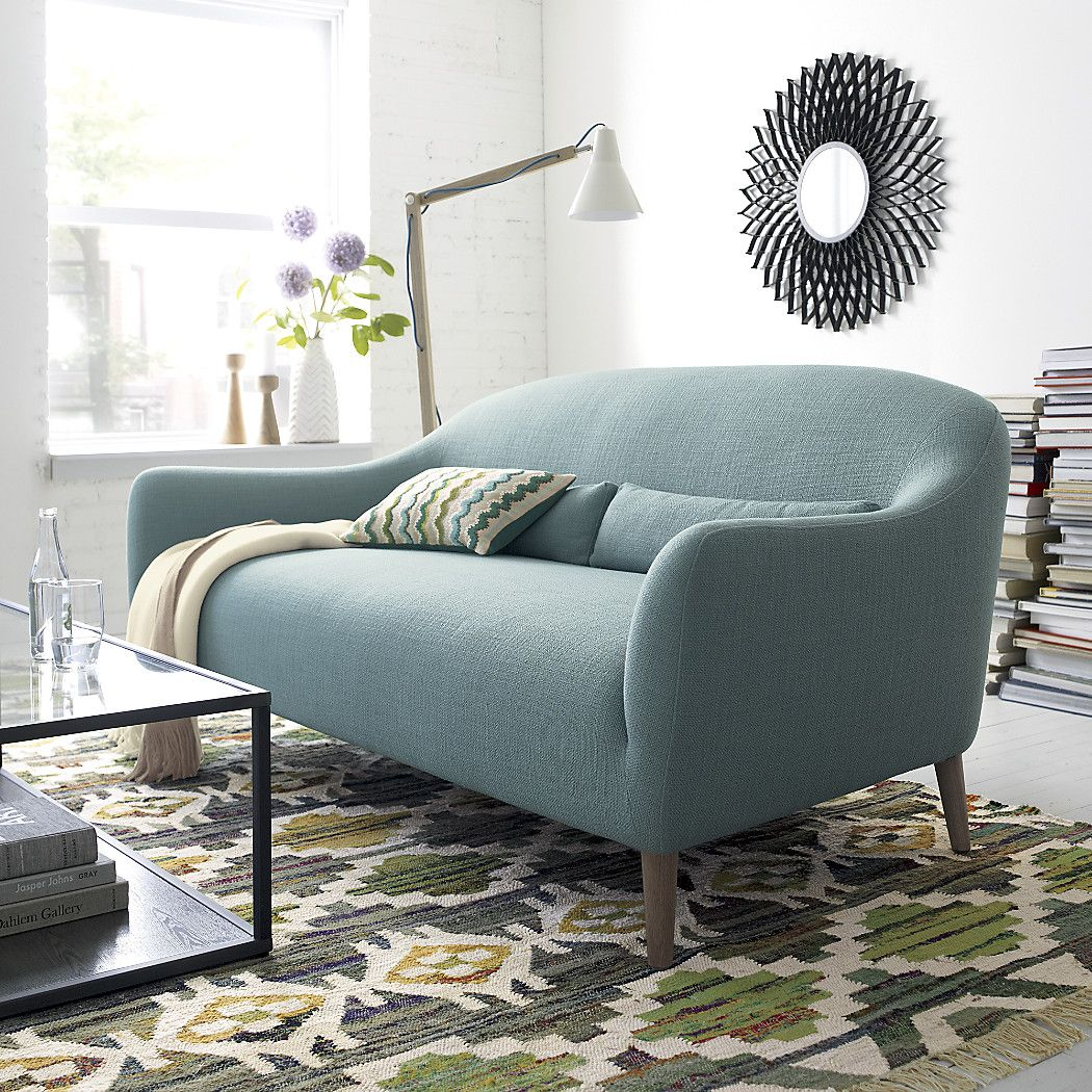 Shop pennie small blue sofa tapered legs are made of solid white