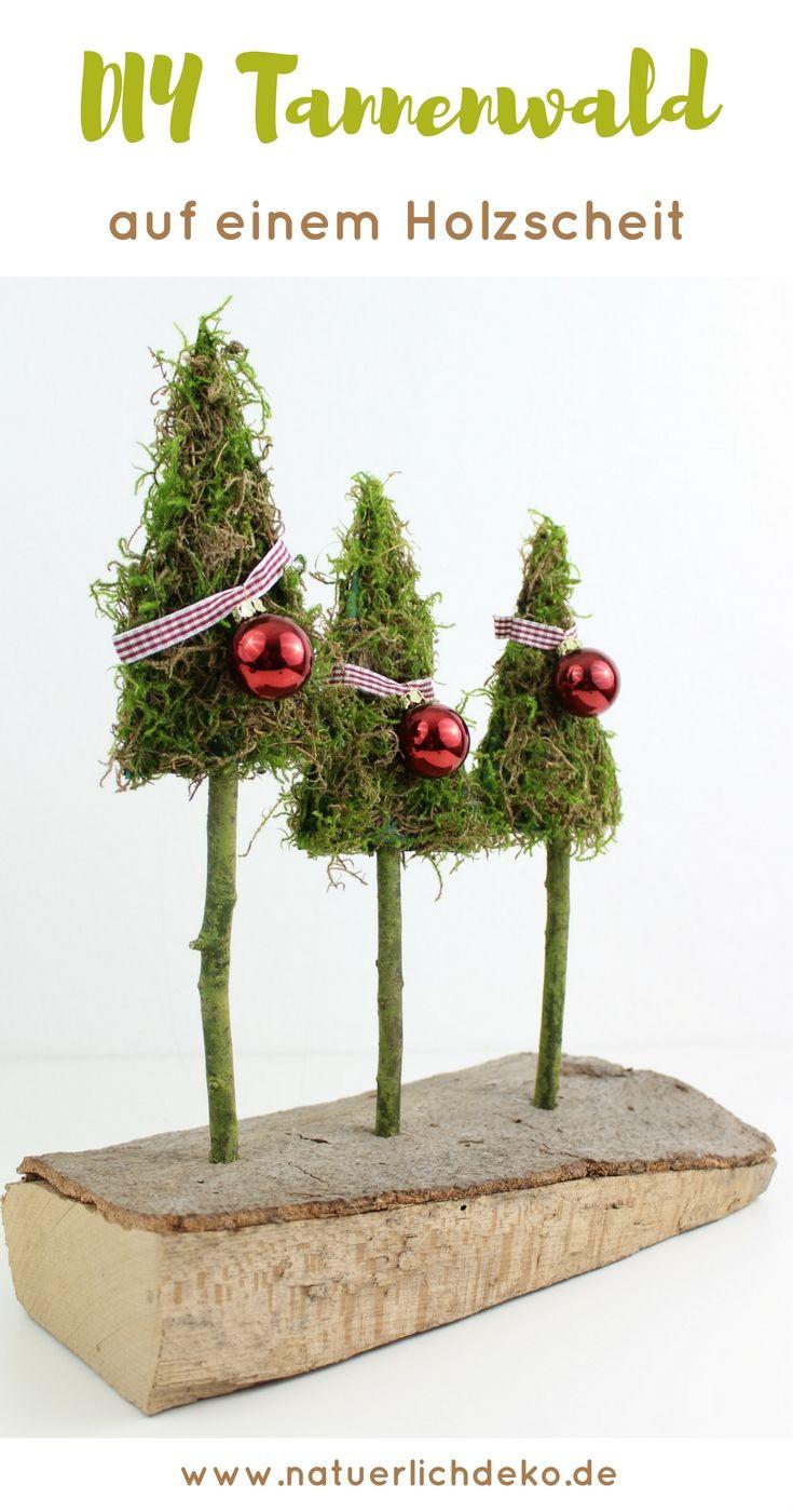 Tannenwald aus Moos auf einem Holzscheit – Natürlich Deko