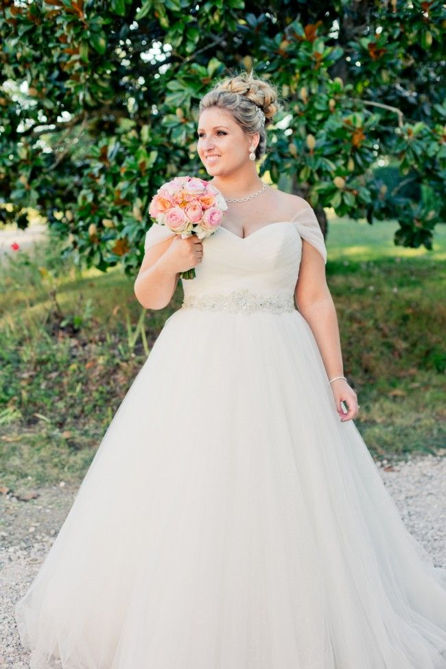 Plus size wedding dresses with ball gown skirts help to hide the hip area.  This empire waist bridal gown has beading detail at the high waist. 6c1dbf4a4072