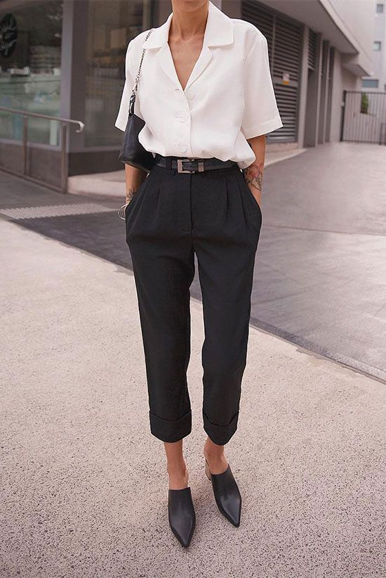 pepamack wearing a white short sleeve shirt black high waist trousers a black belt black mule pumps and a black shoulder bag Workwear workwear women spring work outfits s...