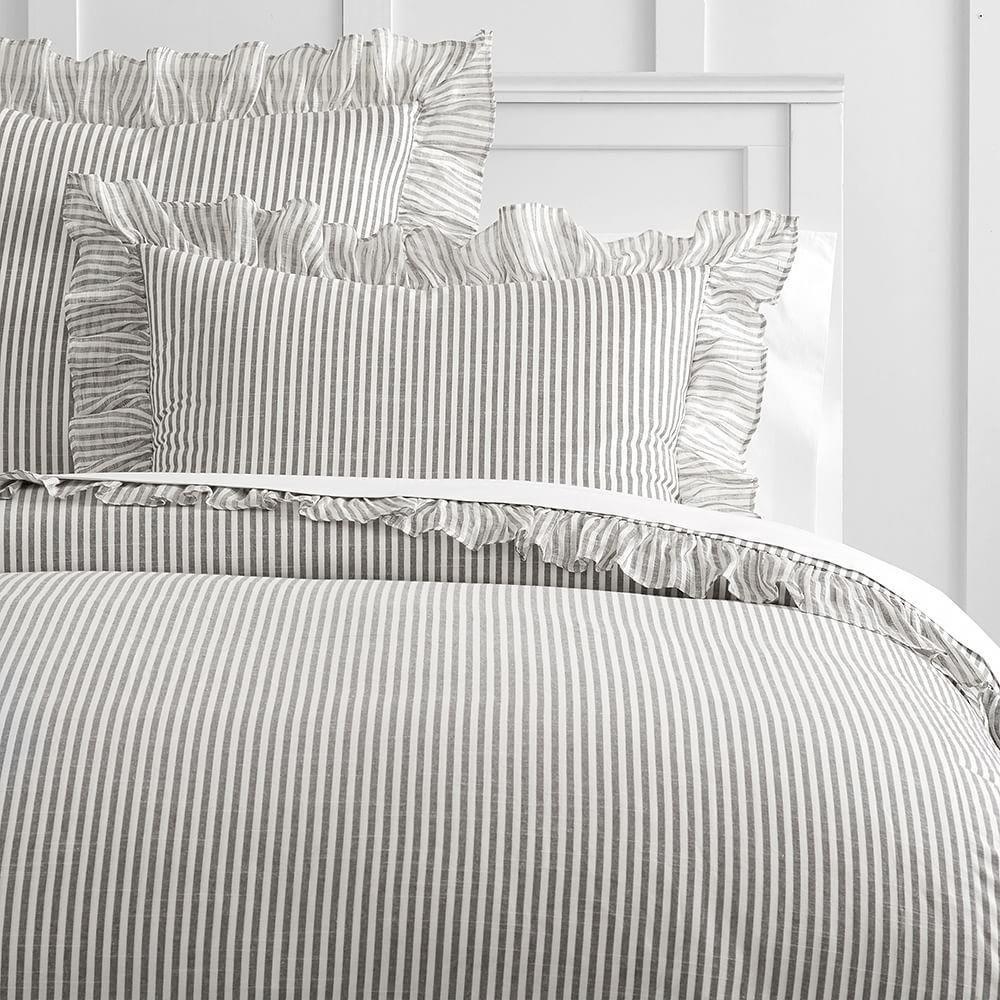 The Emily & Meritt Swiss Dot Bedding Look Grey and gold