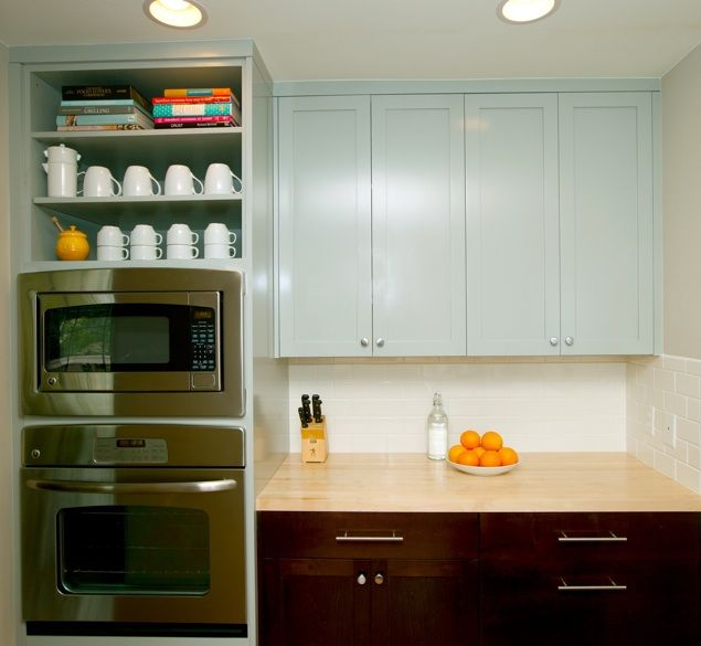 Grey painted cabinets with espresso base cabinets, open shelving, subway backsplash, butcher block counter