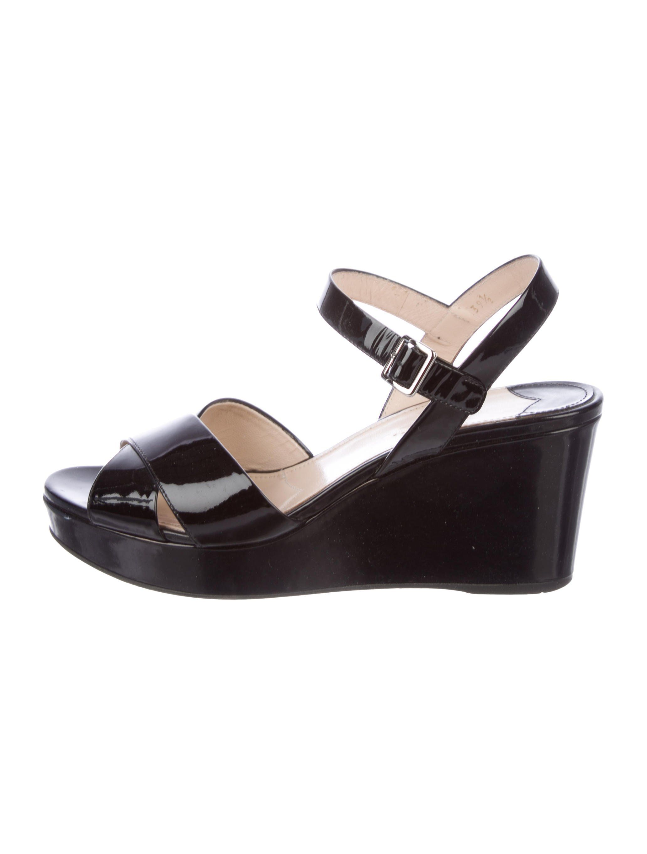 Black Patent Leather Prada Wedge Sandals With Crossover Straps At Tops Covered Heels And Buckle Closures At Wedge Sandals Patent Leather Wedges Patent Leather