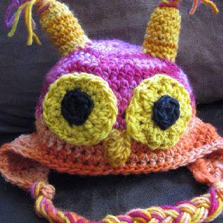 Crocheted owl hat by Jennifer Tan. Pattern featured in www.littleacornlearning enrichment guide.