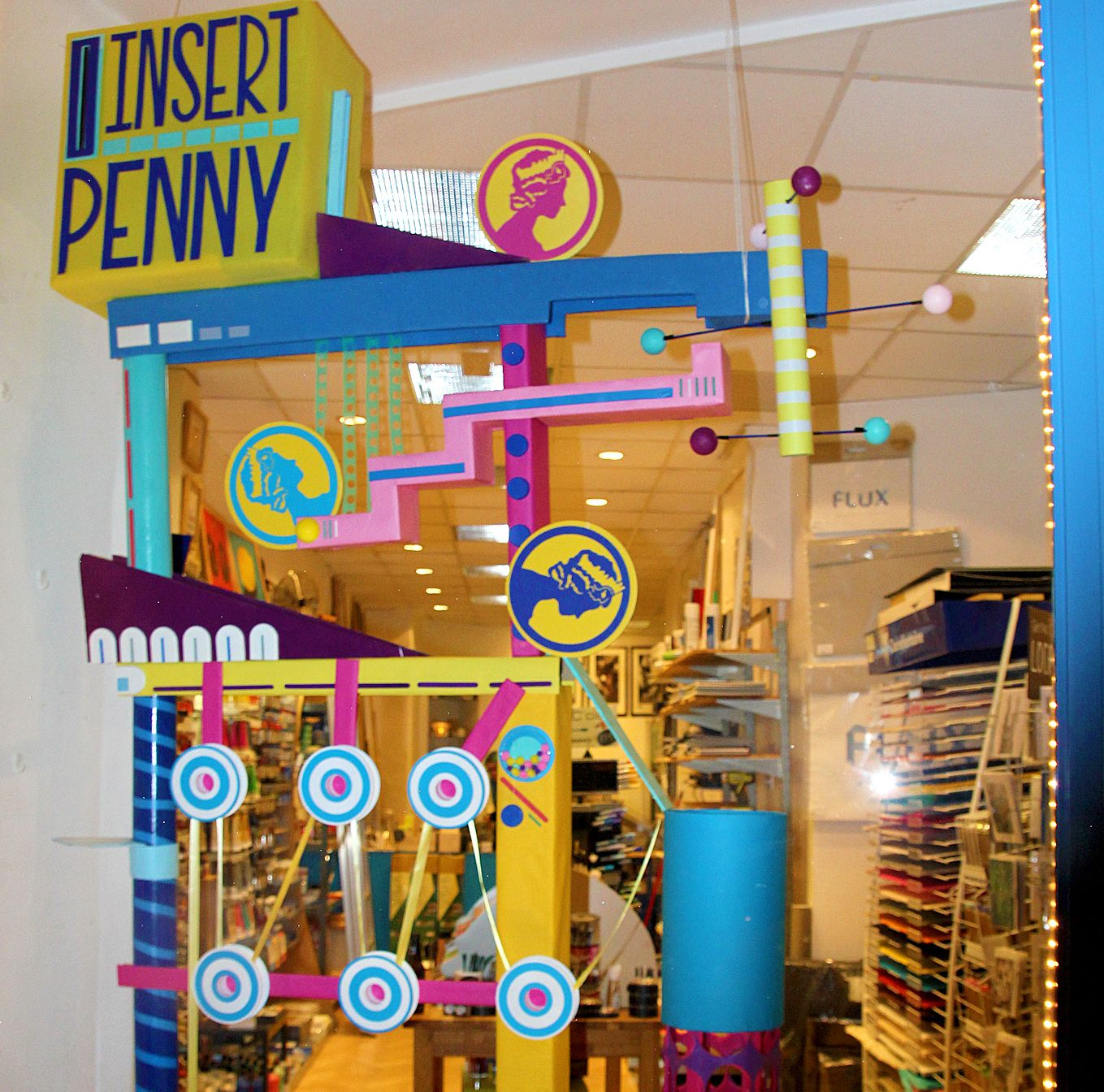 Kristi Minchin is our current window artist. We love her arcade game inspired creation.