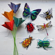 Insects made from two liter bottles and nail polish.