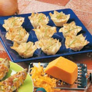 """Caramelized Onion Tartlets Recipe -Jerri Hansen of Council Bluffs, Iowa, fills crunchy phyllo shells with a sweet onion mixture. """"I enjoy experimenting with novel flavors and ingredients,"""" she writes. """"I've used this recipe for open houses and potlucks."""""""