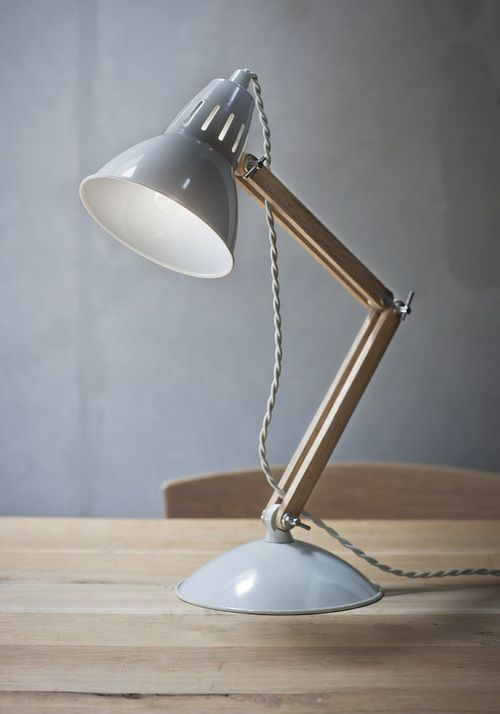 A cool modern retro table lamp with Oak stand & powder coated steel shade and base in a soft grey tone. Perfect accessory for a home office or bed side light.