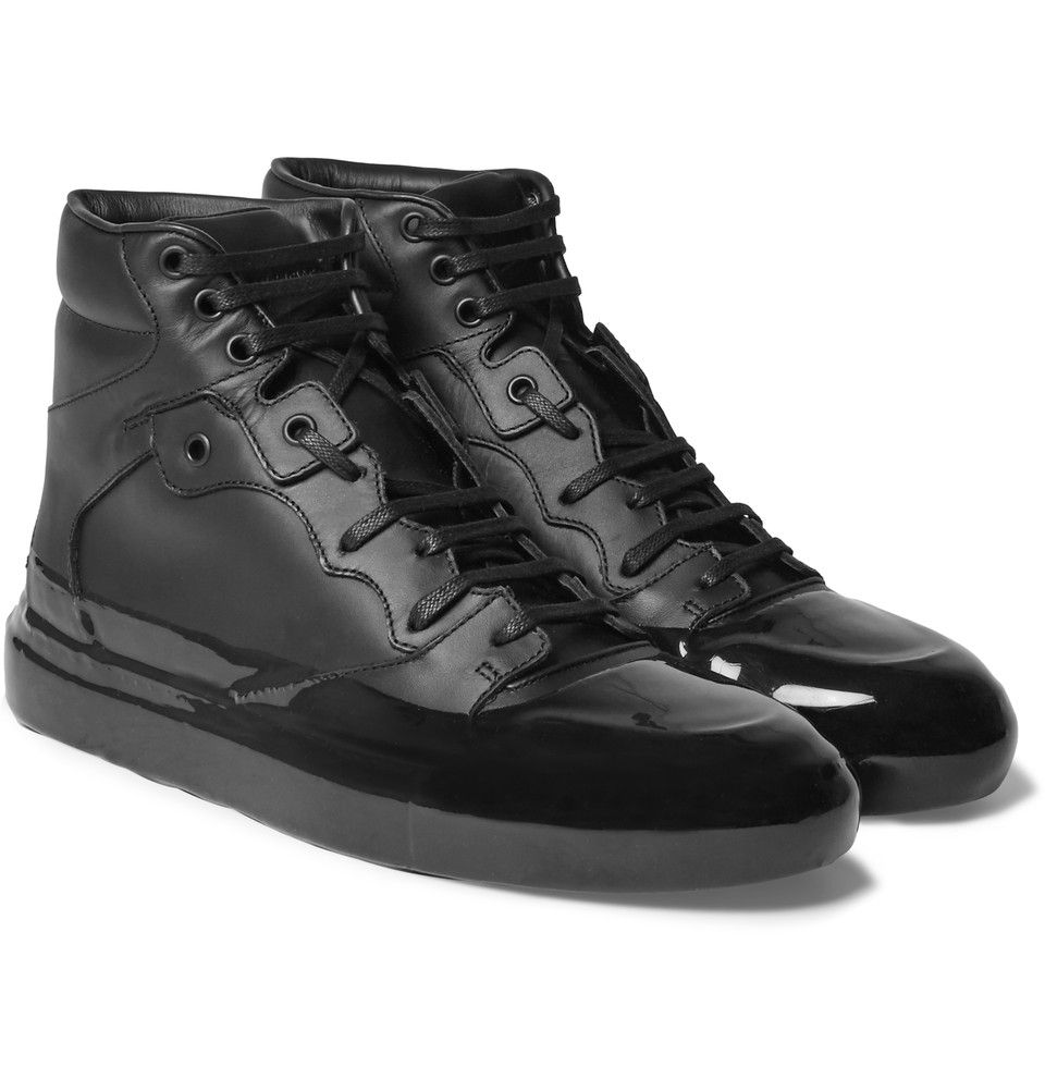 Balenciaga - black Rubberised-Leather High-Top Sneakers 595 EUR. $755 at Barneys.