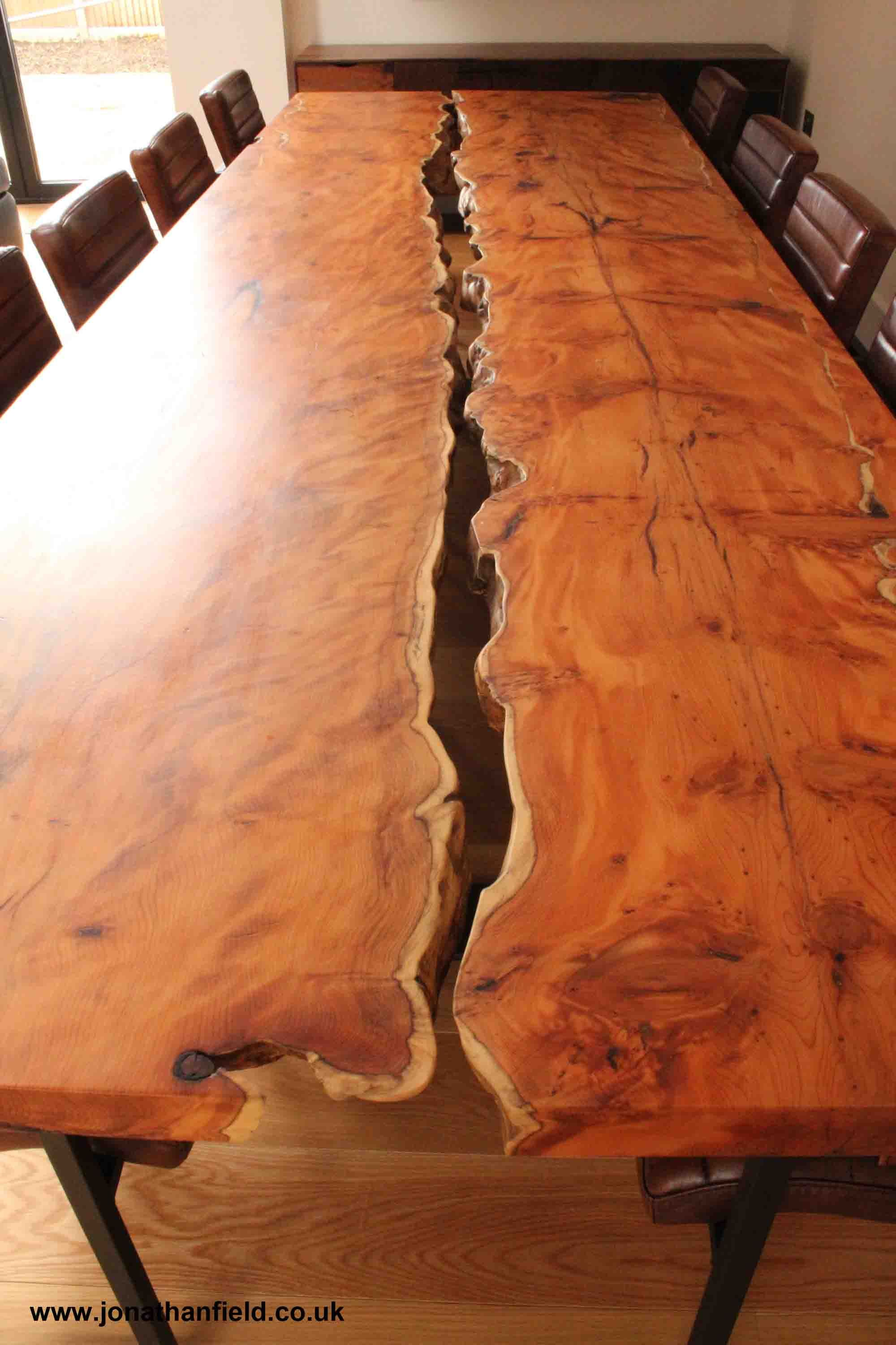 Two Slabs Of Yew With The Waney Edge Facing Inwards Are Held Just Apart On Black Steel Legs To Give A Solid Wood Resin Table Wood Slab Table Slab Dining Tables