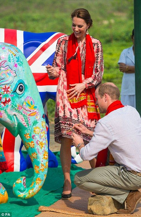 The Duke and Duchess of Cambridge decorate an Elephant Parade statue during a visit to the...
