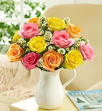 Pitcher Full of Roses - a beautiful assortment of mixes roses in a reusable white pitcher! #rosebouquet #roses #yellowroses #pinkroses #redroses #orangeroses