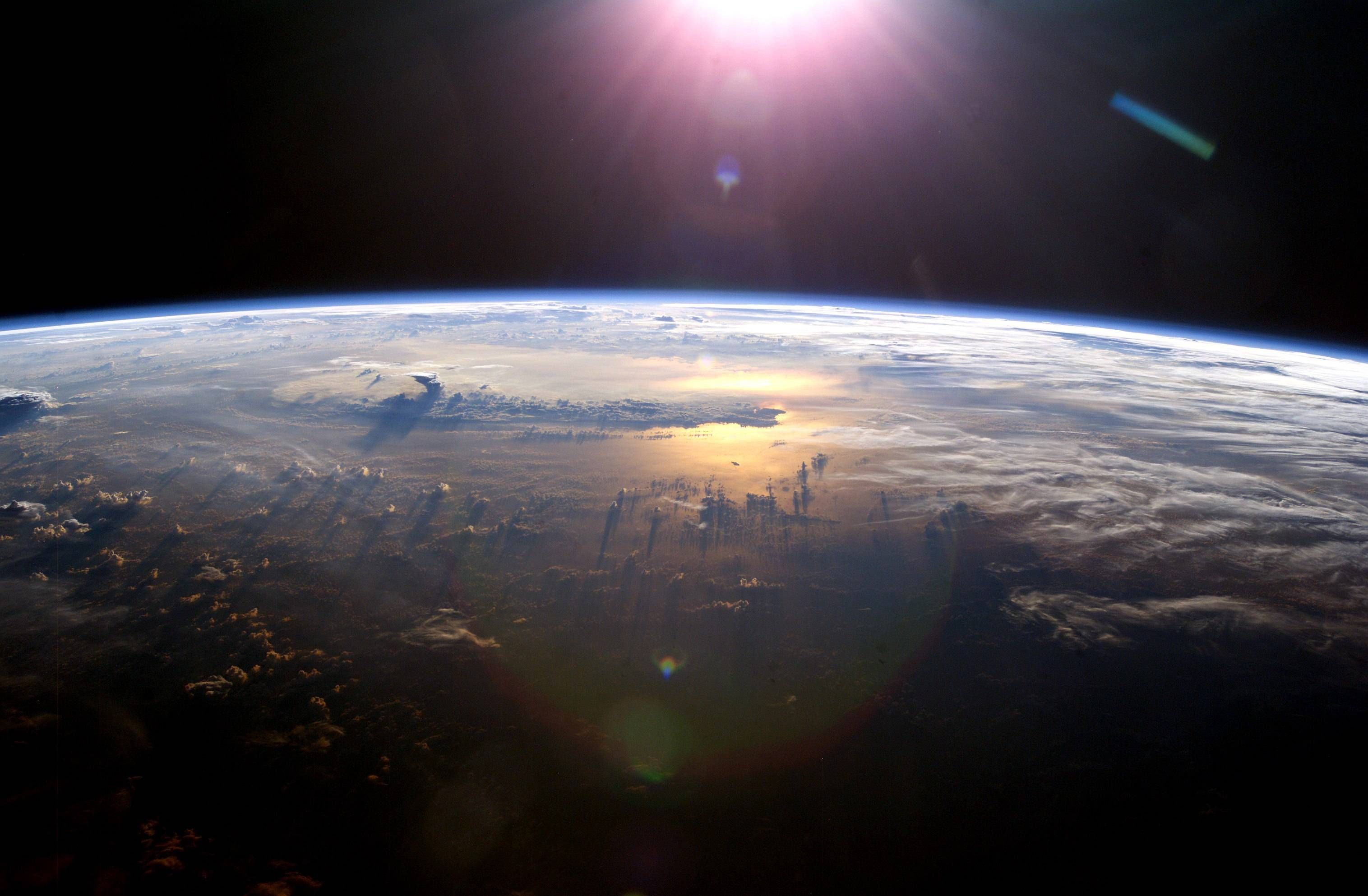 Sun Setting Over The Pacific Ocean As Seen From Iss Earth From Space Ocean Sunset Space Photos Outer space earth sunset space planet