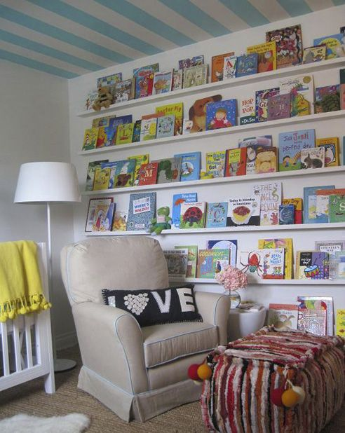 "Love these ""space saving"" bookshelves.  Bonus, kids who can't yet read can easily see what titles are available...    bonus bonus:  check out the striped ceiling..."