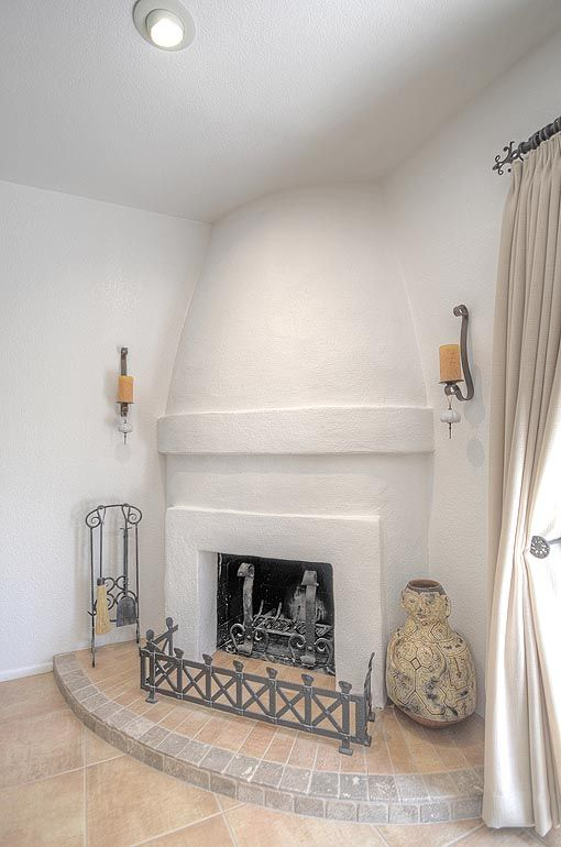Pretty Kiva Fireplace And Oversized Diagonally Set Travertine