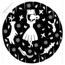 A paper-cut design of a young girl reading a book Wall Decals