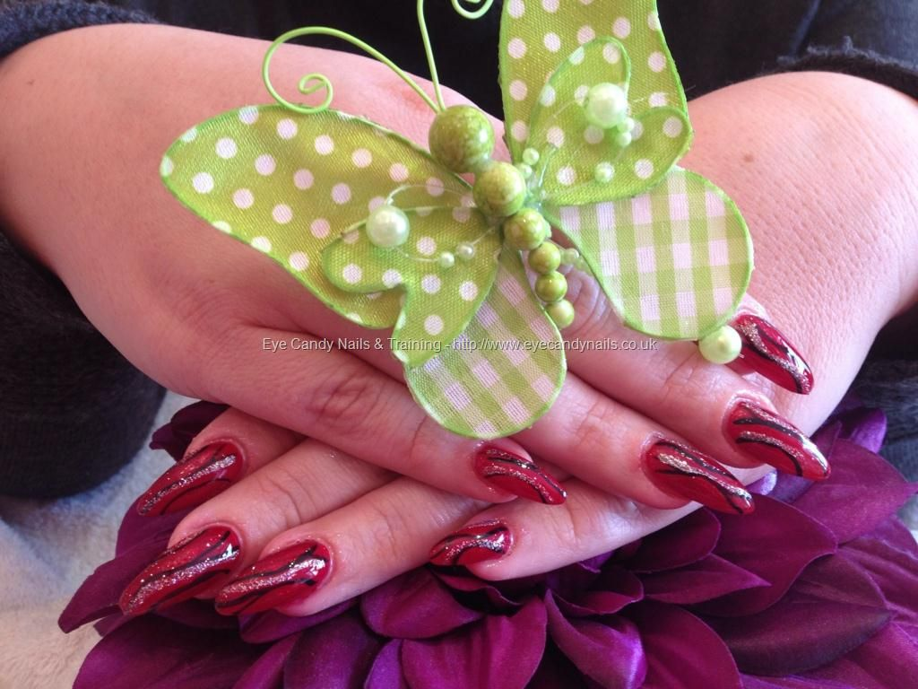 Full set of stiletto nails with red and black nail art | Nails & Toe ...