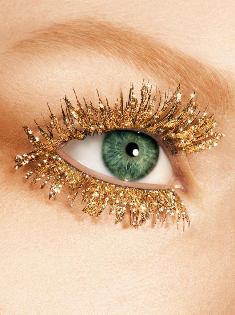 Some gorgeous extreme beauty close ups on lips and eyes adorned with glittery golden mascara by photographer Seb Winter.