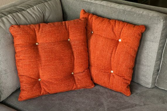 Orange gold buttoned pillows by TheBackSeat on Etsy, $45.00