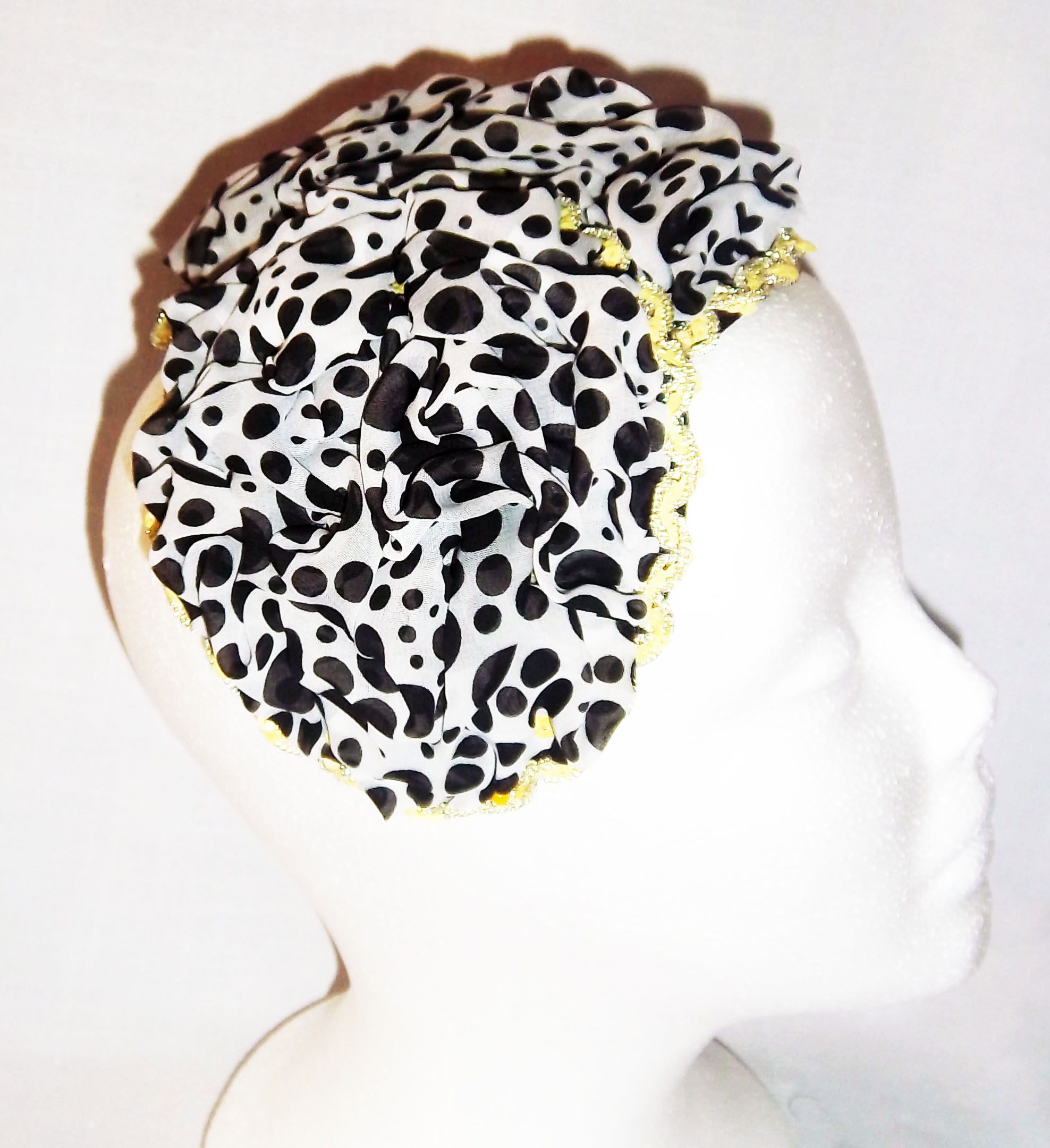 Black and White Polka Dot Hat made by manipulating fabric to create interesting design. Perfect for church, weddings and other special occasions. Trimmed with yellow